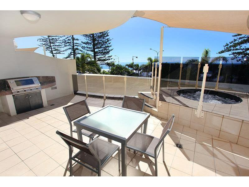 Courtyard & Private Spa Apartment along Mooloolaba Beach.